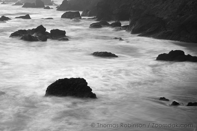 Rocks stand out in the waves below Ecola Point in Cannon Beach