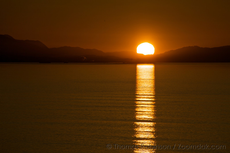 Lux Aeterna - The Eternal Flame<br /> <br /> The sun shines over the Straits of Juan De Fuca at the Dungeness Spit.