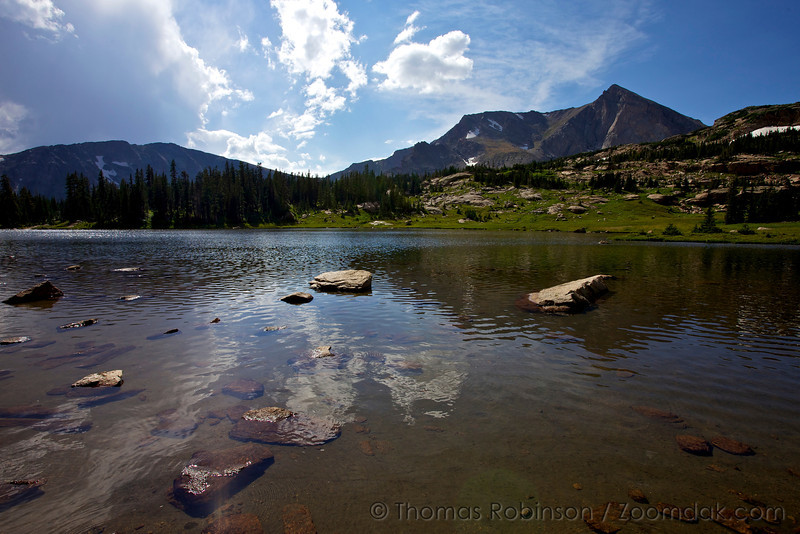 Tanima Peak, Mount Alice and Boulder-Grand Pass reflect on the edge of Lion Lake in Rocky Mountain National Park. The summit of Mt. Alice stands at 13,310ft (4057m).