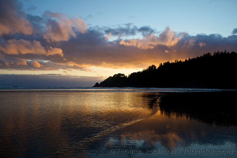 The sun goes down over Shortsands Beach (also called Smuggler's Cove) in Oswald West State Park.