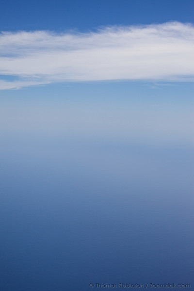 Ocean and sky are hardly distinguishable in the airscape taken from an airplane over the Sea of Cortez.