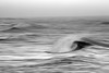 The curl of a wave crests in Yachats Bay, a weight of water, concave and fluid, finding its way from sea to land.