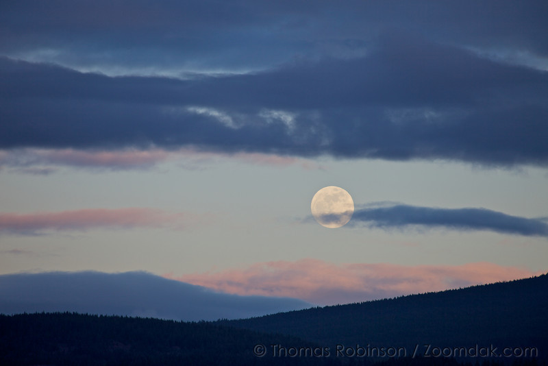 The moon sets over the Columbia River Gorge.