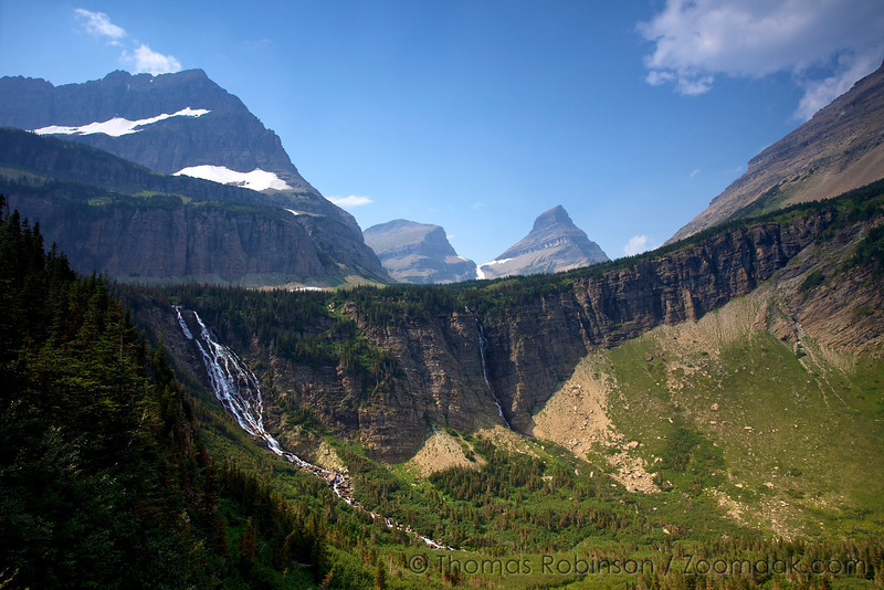 Atsina Falls and Paiota Falls spill out of the basin below Cathedral Peak with Wahcheechee Peaks in the background. Glacier National Park, Montana.