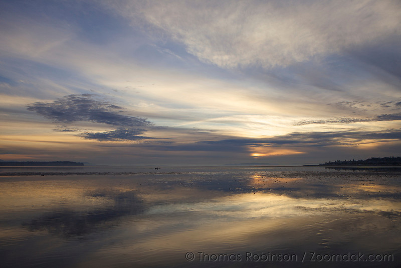 A pastel sunset reflects off of the tide flats of Birch Bay near Bellingham, Washington.