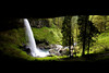 From the cave below, one can see Silver Creek tumbling 136 feet over North Falls in Silver Falls State Park, Oregon.