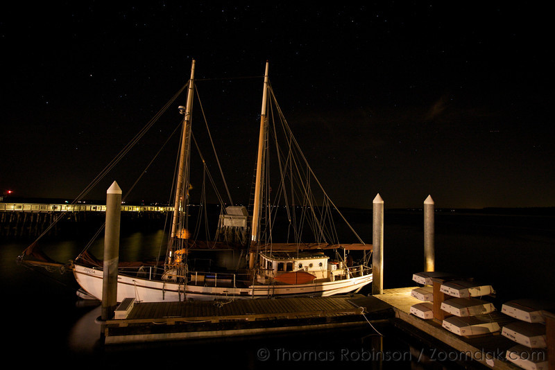 """The Schooner Mycia harbored in Port Townsend at night.<br /> <br /> The Mycia is a hand-made, wooden, Grand Banks-style, gaff-rigged schooner, approximately 73 feet from bowsprit to stern. Adventures and excursions in the Pacific Northwest and Alaska are offered by exclusive arrangement with Captain John Maher and Captain Darcey Maher.<br /> <br /> See <a href=""""http://sailmycia.com/"""">http://sailmycia.com/</a> for more information."""
