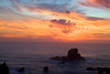 Sunset color erupts in the clouds above Sea Lion rocks at Ecola State Park on the Oregon Coast.