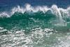 A wave begins to curl at Playa de Amo (Lover's Beach) in Cabo San Lucas, Mexico.