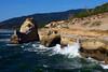 Waves crash off the sandstone cliffs of Cape Kiwanda near Pacific City, Oregon.