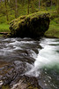 Silver Creek flows over and around layers of basalt rock eroded over time.