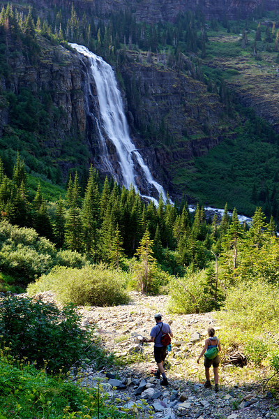 David and Trina Robinson hike near Pyramid Falls below Margaret Lake on the edge of the continental divide in Glacier National Park, Montana.