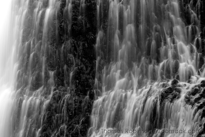A black and detail of a cascading waterfall - Middle North Falls in Silver Falls State Park, Oregon.