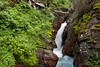 Cataract Creek spills down Hidden Falls in Glacier National Park, Montana.