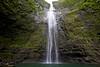 Four miles into the Kalalau Trail along the Na Pali coast, one finds Hanakapi'ai Falls cascading 100 feet into a pool below.