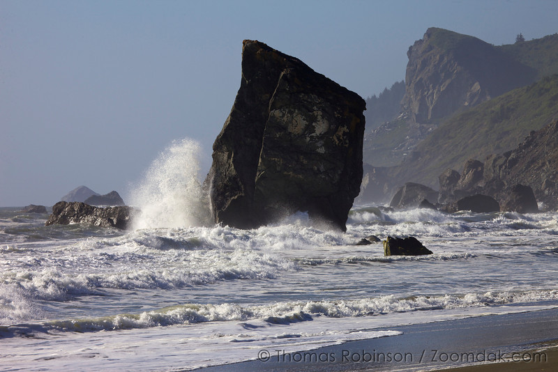 Waves crash against the sea stacks of Carruthers Cove Beach, an amazing secluded stretch of beach in the Redwoods.
