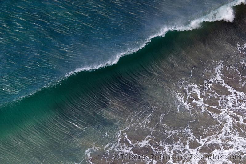 A beautiful wave crests along the Big Sur segment of the California Coast.