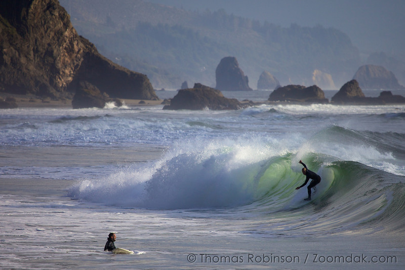 A surfer catches a tubular wave at Indian Beach in Ecola State Park on the Oregon Coast.