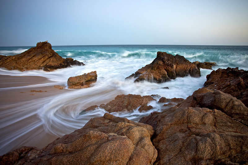 Waves roll in and out after sunset on the along the shores in Baja, Mexico.