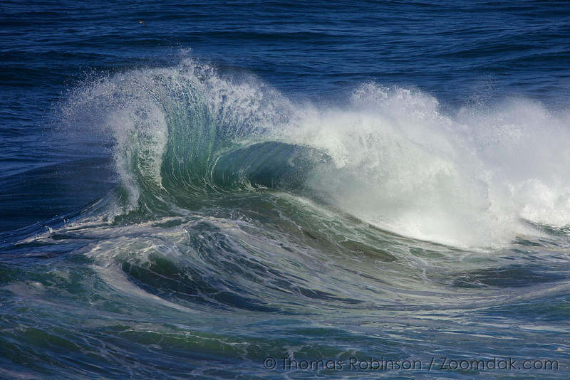 The steep cliffs of Cape Kiwanda rebound waves so that they collide into each other creatings massive wave explosions.