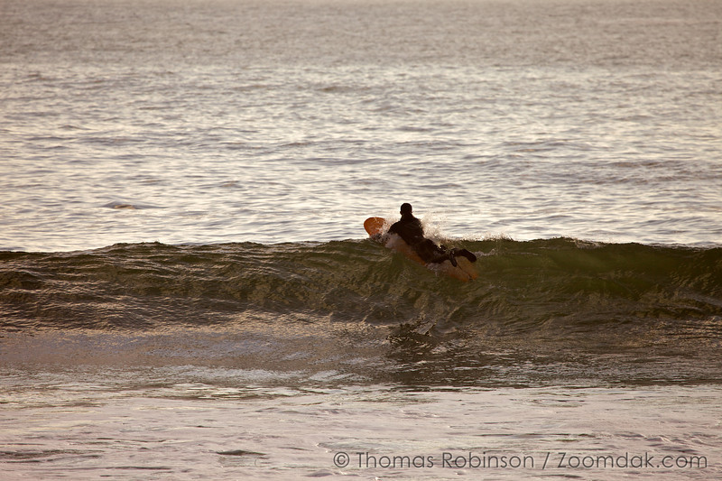 Cory Burnett rides over the swell of a wave at Indian Beach in Ecola State Park, Oregon.