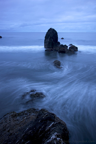 Waves wash around the rocks of Battle Rock beach in Port Orford.
