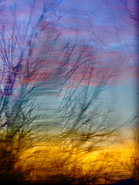 winter sunset through 100 year old glass