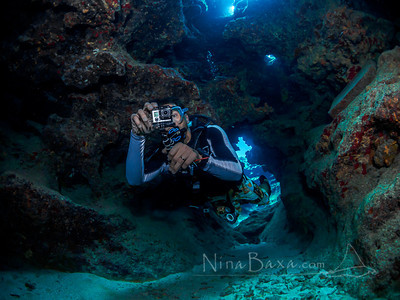 Diver filming the grottoes of Grand Cayman.
