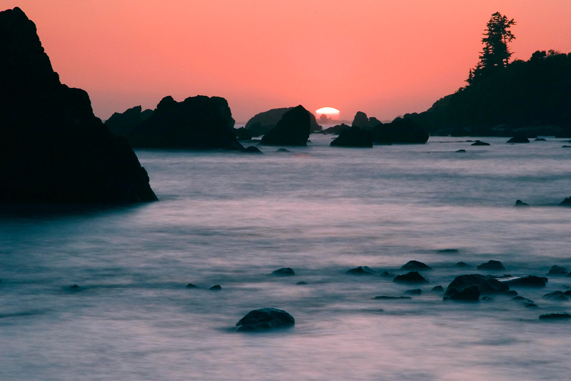 Sunset at Crescent City, CA.  This is an 8 second exposure which would explain the silky look of the ocean.