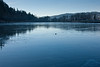 A frozen pond in the Columbia Gorge. The ice was so clean it made me wish I had my ice skates.<br /> <br /> Photo by Dennis
