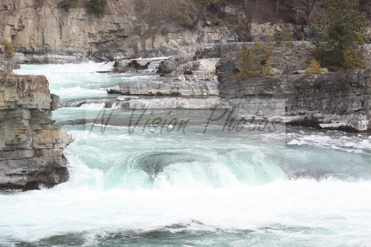 This beautiful section of the Kootenai Rapids below the falls makes for a great screen saver.  Located between Troy and Libby, Montana on Highway 2.