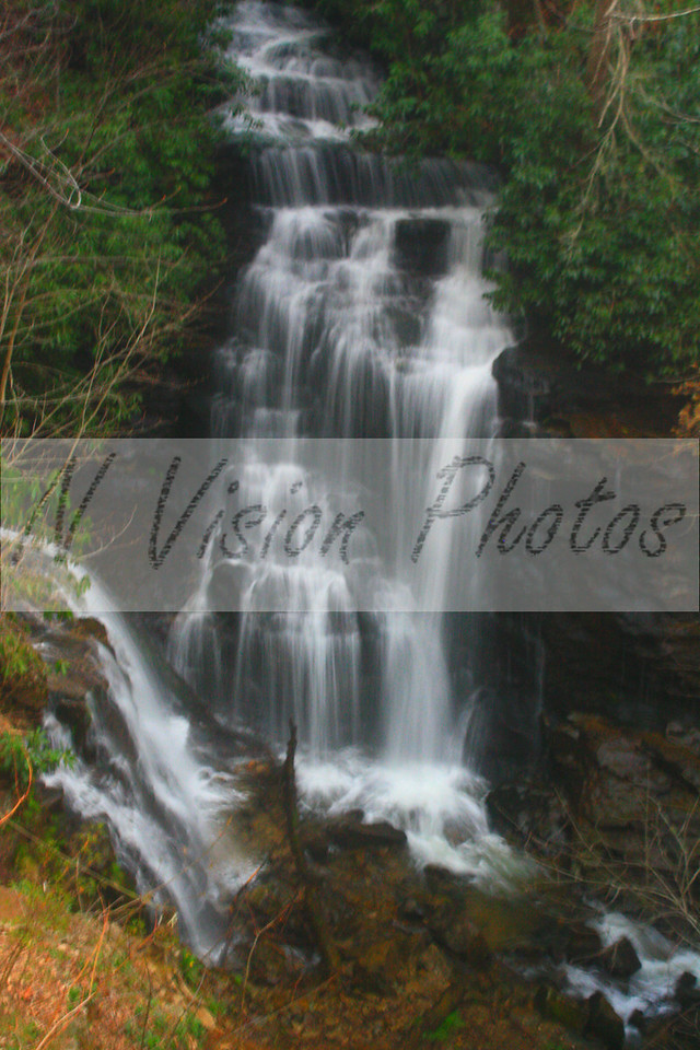 Soco Falls is an incredibly beautiful spot with twin falls forming a single creek at their bases.  35' in height, they consist of short freefalls and vertical cascades.  This is truly a hidden gem just north of Cherokee located on US 19, yet it's location is just below the roadway.  An observation desk allows visitors to enjoy a full view of the right side of the cascades. Taken April, 2013