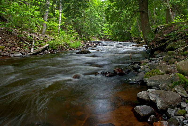 The Carp River flows toward Marquette Mountain.