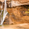 Calf Creek Falls in Grand Staircase-Escalante National Monument, with trees beginning to turn fall colors.