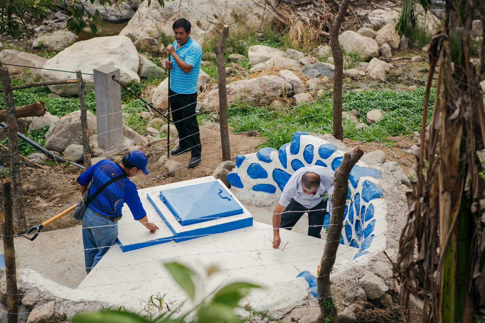 Community members examining a well in Cascas, Peru.