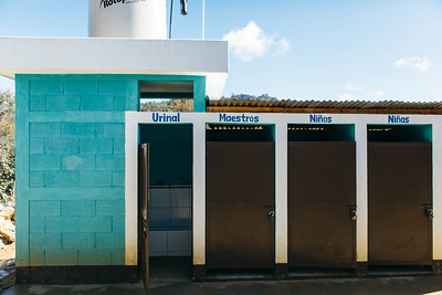 A toilet block at a school in Guatemala. There are separate stalls for girls, boys, and teachers.