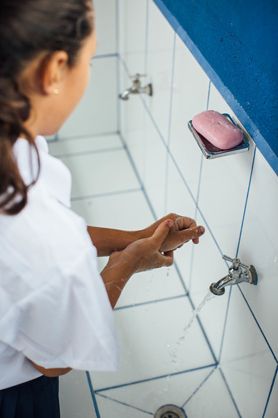 A student washes her hands at a school in Nicaragua. Hygiene education in schools ensure that healthy habits are learned at an early age.