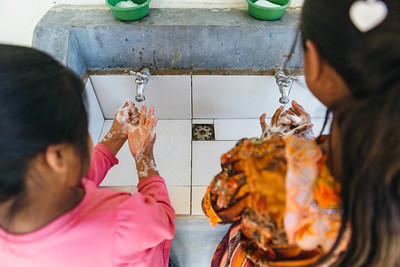 Two girls show off their handwashing technique at a school in Guatemala. Teaching good hygiene habits at a young age keeps kids healthy and in school!