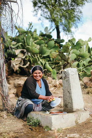 Norah washes dishes at her family's newly installed water tap in rural, Bolivia. Read her full story: www.waterforpeople.org/stories/the-town-of-thagoni