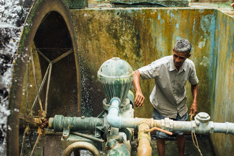 A man at a water point in Honduras.