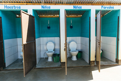 A toilet block at a school in Guatemala. Pictured here are designated sections for girls, boys, preschoolers, and teachers.