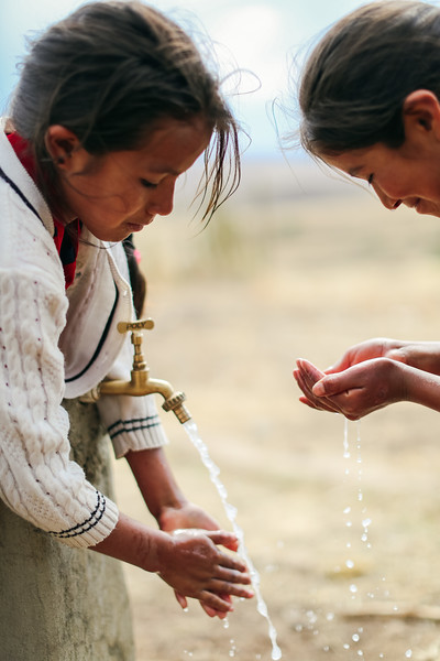Two girls wash their hands in Bolivia. Handwashing can reduce diarrhea cases by 50%. This simple solution improves the health of entire communities and can saves lives.  This is why we educated over 220,000 people about hygiene in 2017.