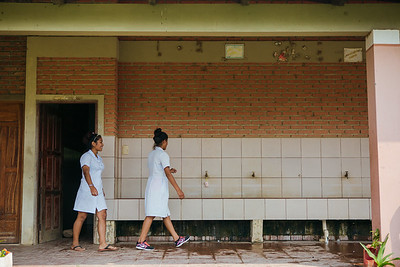 Students in Bolivia wash their hands at a sanitation block constructed at their school.