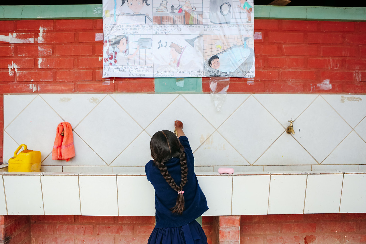 A young student washes her hands at school. Handwashing can reduce diarrhea cases by 50%. This simple solution improves the health of entire communities and can saves lives.  This is why we educated over 220,000 people about hygiene in 2017.