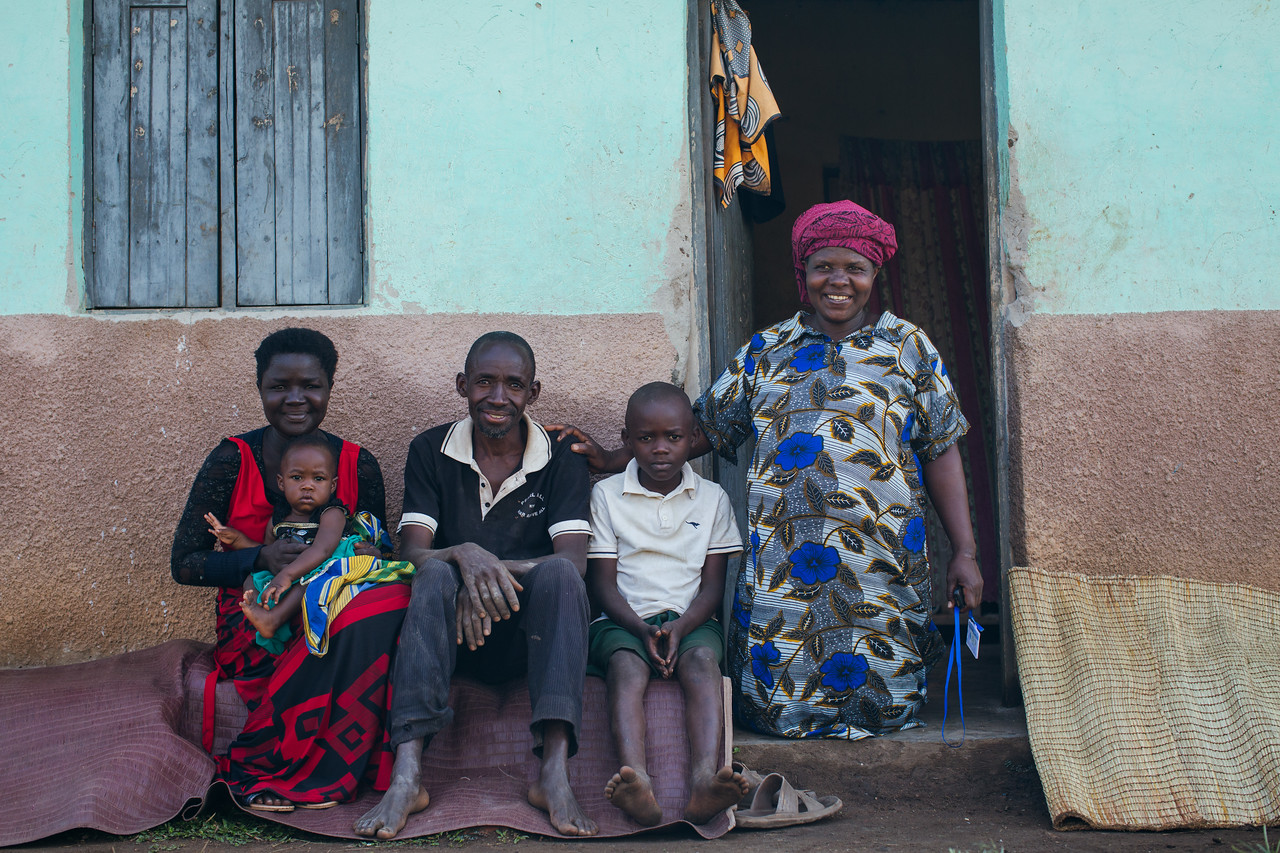 A family outside their home in Uganda.