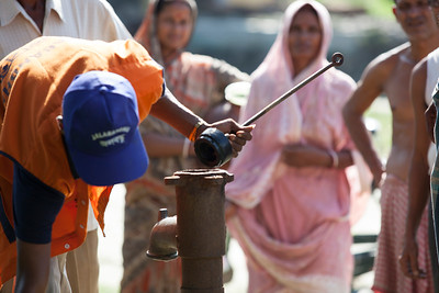 "The Jalabandhu (""friends of water"") is group of mobile hand pump mechanics supported by Water For People in India. Here a mechanic works on a water point."