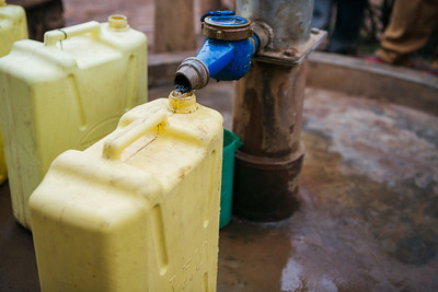 A jerry can being filled at a metered water point in Uganda.
