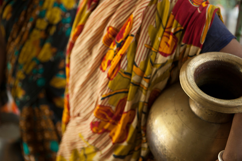 A woman in India carries a water vessel.