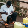 """Laban is employed as a water seller in his community in Uganda. He maintains the tap and keeps meticulous records of water users. Read Laban's story: <a href=""""https://www.waterforpeople.org/stories/local-water-guardians-the-water-sellers#.WXIpgYgrIUE"""">https://www.waterforpeople.org/stories/local-water-guardians-the-water-sellers#.WXIpgYgrIUE</a>"""