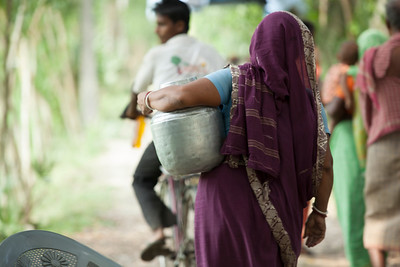 A woman walks with a water vessel in India.  Learn more about our work in India: https://www.waterforpeople.org/where-we-work/india
